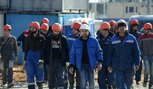 Застройщики не планируют сокращать количество рабочих на столичных стройках